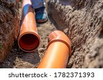 Laying Drainage Pipes Into The...