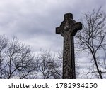 A Celtic Cross Next To The...