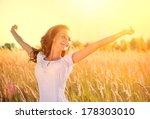 beauty girl outdoors enjoying... | Shutterstock . vector #178303010