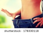 woman showing how much weight...   Shutterstock . vector #178330118