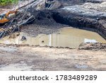 Small photo of Excavation pit with groundwater, dewatering in construction.