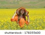 beautiful woman on blooming... | Shutterstock . vector #178355600
