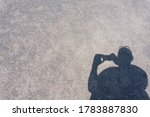 Shadow Image Of A Man Taking A...