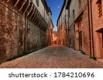 Forli, Emilia Romagna, Italy: picturesque ancient alley in the old town - Old Italian street at dusk paved with cobblestone