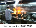 chef in restaurant kitchen at... | Shutterstock . vector #178425740