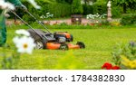 Banner. A Human Lawn Mower Cuts ...