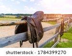 Horse Saddle Hanging On A Fence ...