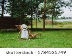 Wooden Deck Chair Under The Tree