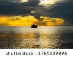 Silhouette Of The Boat Is At...