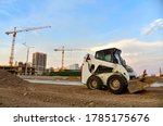 Skid Steer Loader Working At...