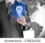 business man touching light of... | Shutterstock . vector #178526150