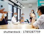 Small photo of diverse business worker discuss and meeting while Wearing Medical Mask as protection from corona virus. New normal office working. Group of multiethnic people in business reopen. flu prevent healthy