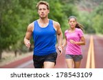 running couple jogging on road. ... | Shutterstock . vector #178543109
