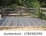 Wooden Fence With Cattle Grids...