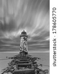 A Deserted Lighthouse With A...