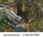Aerial view of beautiful waterfall in rocky  area. Drone Photo.