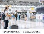 Young Woman Traveler Wearing...