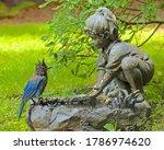 wet Blue Jay at a birdbath - stock photo