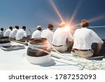 Rear View Of Sailing Crew With...