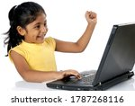 Small photo of Mumbai, Maharashtra, India- Asia, June. 07, 2008 - Educational software for student Indian Asian little cute girl studying using laptop technology education at home concept on white background