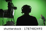 Film Crew In Green Studio...