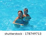 mother teaches her son to swim... | Shutterstock . vector #178749713