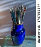 Artist's Paintbrushes In A Blue ...