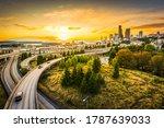Small photo of Seattle skylines and Interstate freeways converge at sunset, Seattle, Washington, USA.