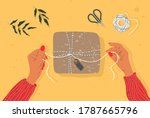 hands and gift box on the table....   Shutterstock .eps vector #1787665796