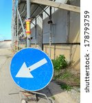 Blue Road Sign By A Metal...