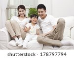 young family sitting in couch  | Shutterstock . vector #178797794