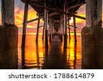 Under The Newport Pier At Sunset
