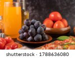 Black Grapes On A Wooden Plate...