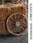 An Old Wooden Wheel From A Car...