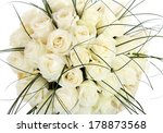 A large bouquet of white roses. A huge bouquet of cream roses. The isolated image on a white background. - stock photo