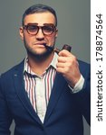 man with a smoking pipe in... | Shutterstock . vector #178874564