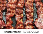 bacon slice being cooked in... | Shutterstock . vector #178877060