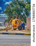Worker Repairing A Trailer Wit...