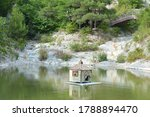 small house in the lake among... | Shutterstock . vector #1788894470