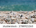 A Sea Of Pebbles By The Sea