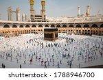 Small photo of Muslim pilgrims in Al Haram Mosque Makkah performing Tawaf , Hajj Season at the time of the Corona Covid 19 , Covid 19 precautionary measures.Saudi Arabia makkah at Aug 2020