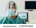 Small photo of Doctor wearing ppe face surgical mask and visor fighting against corona virus outbreak - Health care and medical workers concept