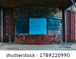 A Boarded Up Ticket Booth At A...