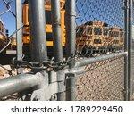 School buses behind a locked...
