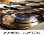 Lit Gas Burner On The Kitchen...