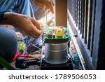 A Technician Assembling Motor...