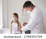Doctor with mouth mask gives...