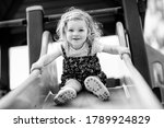 Cute Toddler Girl Playing On...