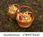 Two Wooden Baskets Full With...