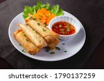 Fried Spring Rolls On A White...